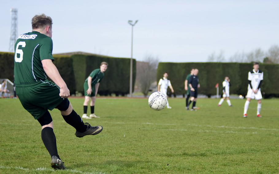 Alconbury senior Nick Brinegar boots the soccer ball during a high school game against SHAPE at RAF Alconbury, England, Saturday, March 23, 2019. SHAPE beat the Dragons by halftime with a 7-0 score.