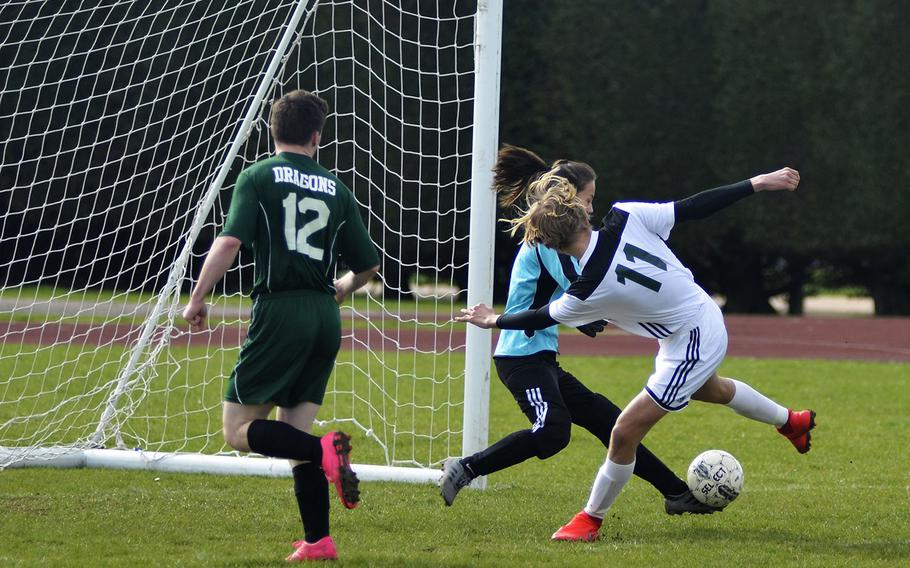 Alconbury's sophomore goal keeper Alyssa Beighle blocks a shot from SHAPE player Sverre Loso during a high school soccer game at RAF Alconbury, England, Saturday, March 23, 2019. Beighle had 14 saves and multiple grabs.
