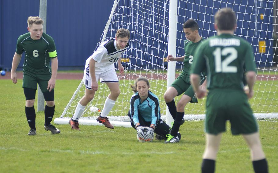 Alconbury's sophomore goalkeeper Alyssa Beighle secures the soccer ball during a high school game against SHAPE at RAF Alconbury, England, Saturday, March 23, 2019. Beighle had 14 saves and multiple grabs.
