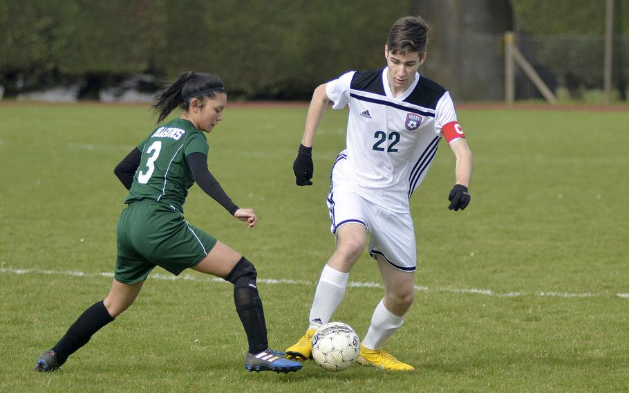 Alconbury's Amilia Cabugao faces off against SHAPE defender Gonzalo Vijande during a high school soccer game at RAF Alconbury, England, Saturday, March 23, 2019. The Dragons have a co-ed soccer team for the first time this season.