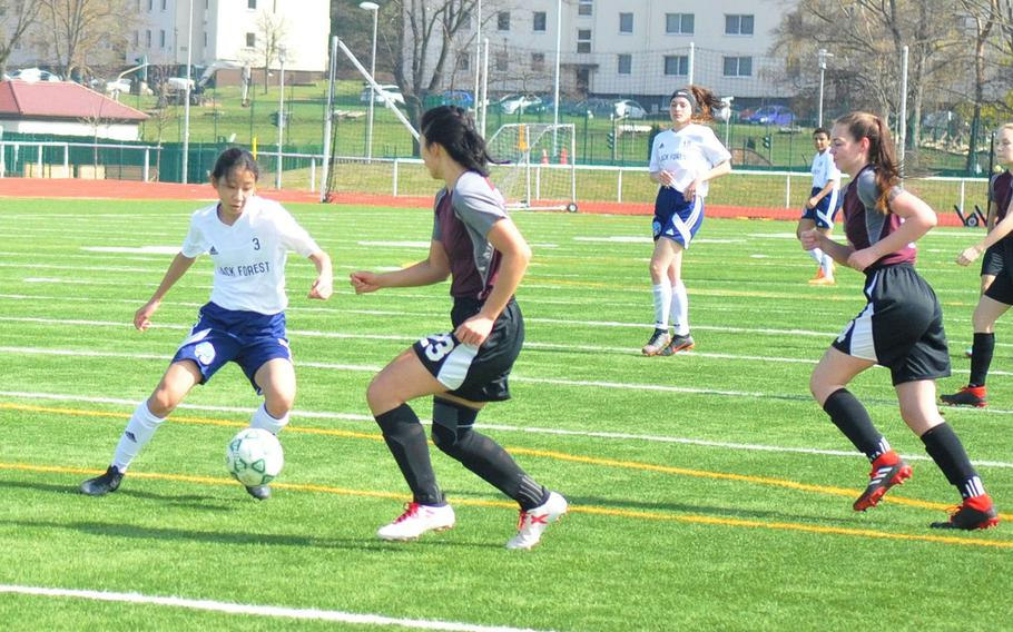Black Forest Academy freshman Yewon Park makes a move in her team's 6-0 defeat of the AFNORTH Lions on Saturday, April 6, 2019, at Kaiserslautern High School. Park scored three goals.