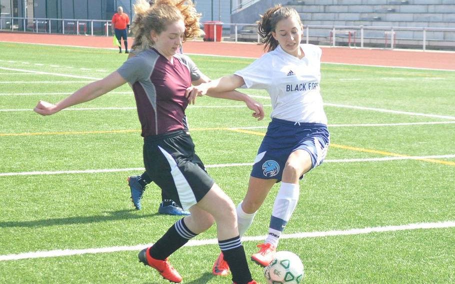 Black Forest Academy's Becca Losey and AFNORTH's Stella Gage compete for a ball Saturday, April 6, 2019, at Kaiserslautern High School. Black Forest earned a 6-0 shutout victory.