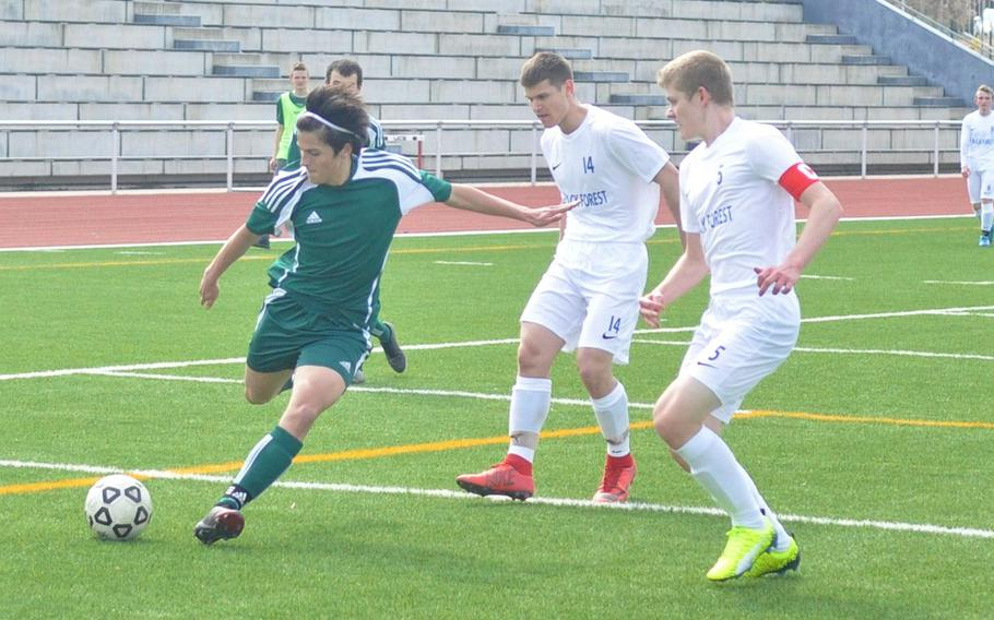 AFNORTH Lions star James Barata attempts a shot against heavy Black Forest Academy defense Saturday, April 6, 2019, at Kaiserslautern High School. Barata scored all three of his team's goals in a 3-1 victory.