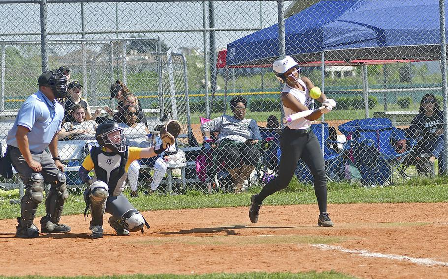 Naples' Mia Rawlins delivers a deep hit that scored a few runs during the game between Naples and Wiesbaden that took place Saturday, April 20, 2019, at Caserma Del Din, in Vicenza. Naples ended up winning the game 9-3.