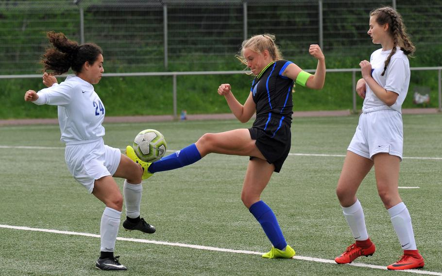 Brussels Sophia Beckley, left, blocks a shot attempt by Hohenfels' Lucy Wylie in a Division III game at the DODEA-Europe soccer finals in Landstuhl, Monday, May 20, 2019.