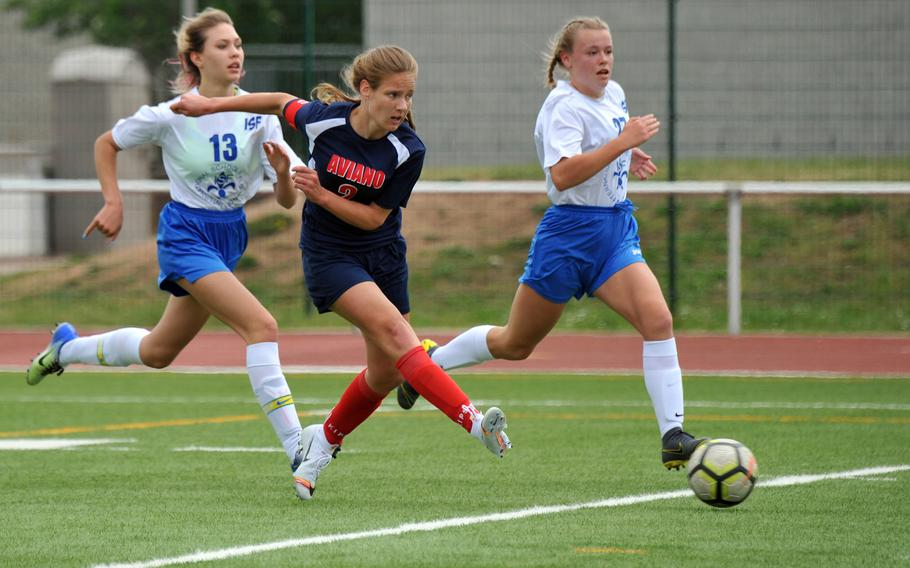 Aviano's Danielle Kandle gets off a shot after getting past Florence's Tatiana Pronina, left, Yeva Biba in a Division II game at the DODEA-Europe soccer finals in Kaiserslautern, Monday, May 20, 2019. Aviano won 3-0.
