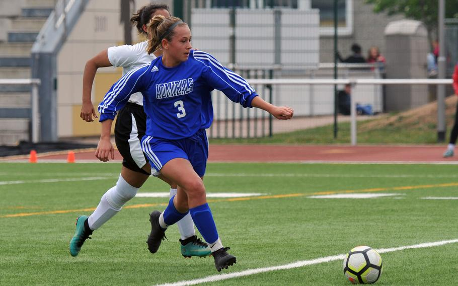 Rota's Kendall Salazar gets away from AFNORTH's Alexa Sicardo in a Division II game at the DODEA-Europe soccer finals in Kaiserslautern, Monday, May 20, 2019. Rota won 3-0.