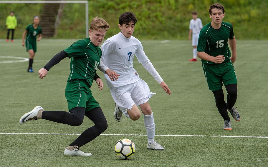 Alconbury's Cameron Rowley and Brussels' Kamran Mammadov race for the ball on the third day of the DODEA-Europe soccer championships, Wednesday, May 22, 2019.