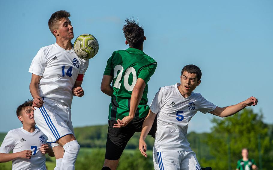The ball goes off the shoulder of Wiesbaden's Anthony Hall during a Division I semifinal game against Naples on the third day of the DODEA-Europe soccer championships, Wednesday, May 22, 2019.