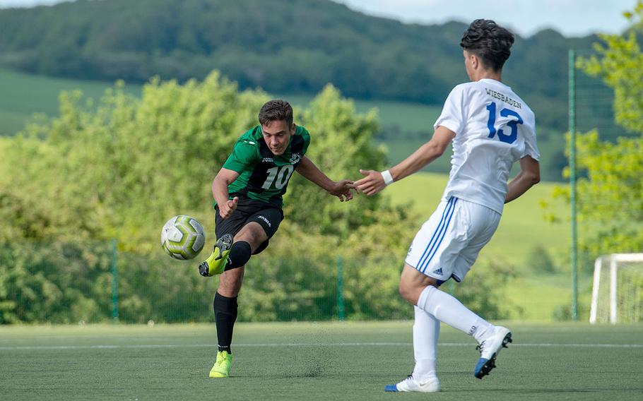 Naples' Nikolas Mihalik takes a shot on goal during a Division I semifinal game against Wiesbaden on the third day of the DODEA-Europe soccer championships, Wednesday, May 22, 2019.