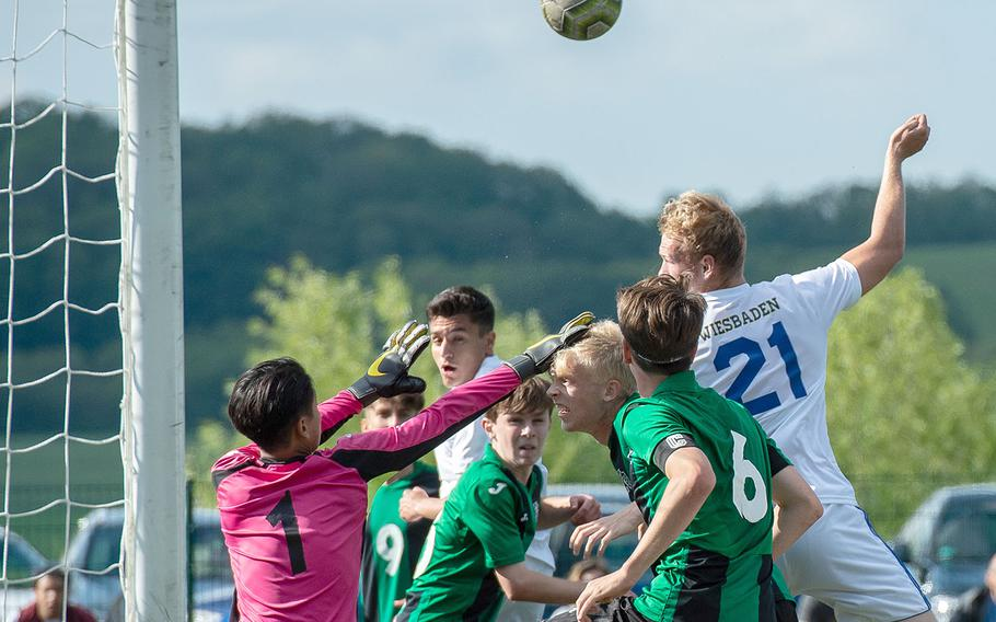 Player from Naples and Wiesbaden charge the goal during a Division I semifinal game on the third day of the DODEA-Europe soccer championships, Wednesday, May 22, 2019.