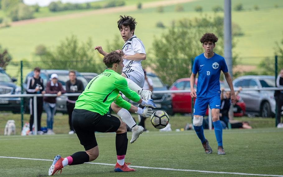 Ramstein's Garrett Erickson stop a shot from SHAPE's Joseph Kraemer during a Division I semifinal game on the third day of the DODEA-Europe soccer championships, Wednesday, May 22, 2019.