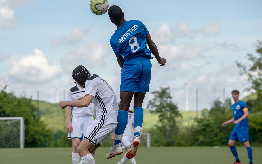 Ramstein's Chukwuemeka Alumanah head the ball toward the goal during a Division I semifinal game against SHAPE on the third day of the DODEA-Europe soccer championships, Wednesday, May 22, 2019.