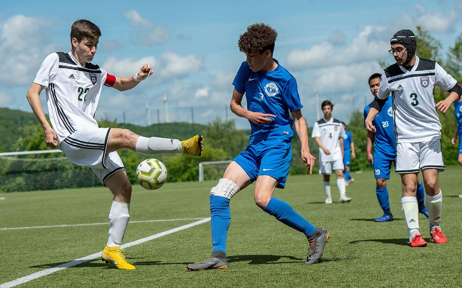 Ramstein's Hunter Smith block a kick from SHAPE's Gonzalo Vijande during a Division I semifinal game on the third day of the DODEA-Europe soccer championships, Wednesday, May 22, 2019.