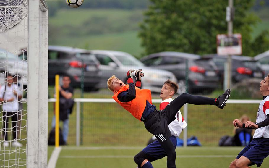 Florence keeper Lorenzo Budroni watches his save of an Aviano shot bounce off the crossbar in a Division II semifinal in Reichenbach, Wednesday, May 22, 2019. Aviano won the game 1-0 and will face AOSR in Thursday's final.