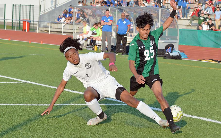 Ramstein's Jerrell Brevard makes a perfect tackle on Wutthipong Khotsaeng in the boys Division I final at the DODEA-Europe championships in Kaiserslautern, Thursday May 23, 2019. Naples captured the title with a 1-0 win.