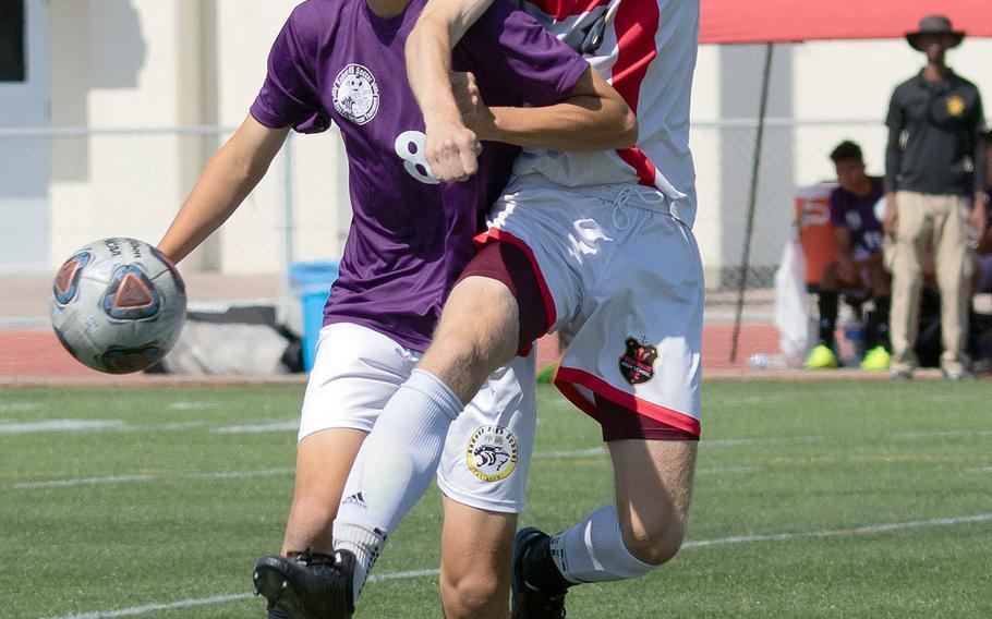 Kadena's Sean Fletcher and Kinnick's Jack Boran try to play the ball.