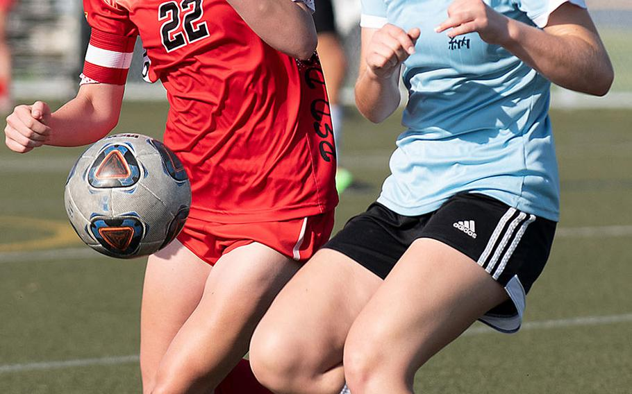 Kinnick's Maggie Donnelly and Kadena's Ella Powell battle for the ball.