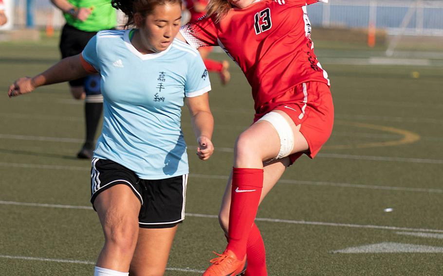 Kadena's Arisa Armel and Kinnick's Jillian Mock battle for the ball.