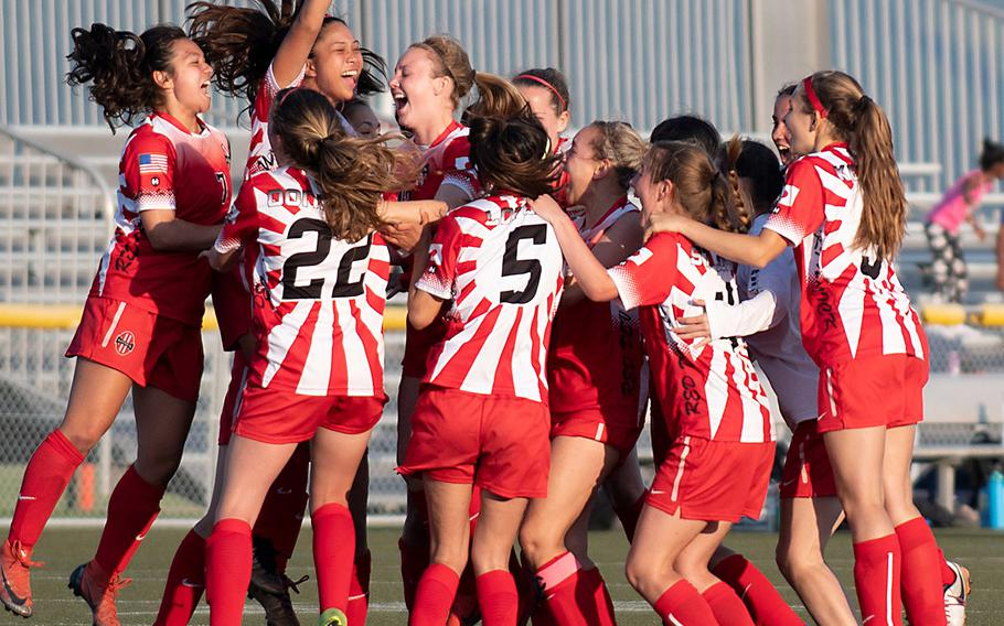 Kinnick's girls players celebrate their second Far East Division I title in three years.