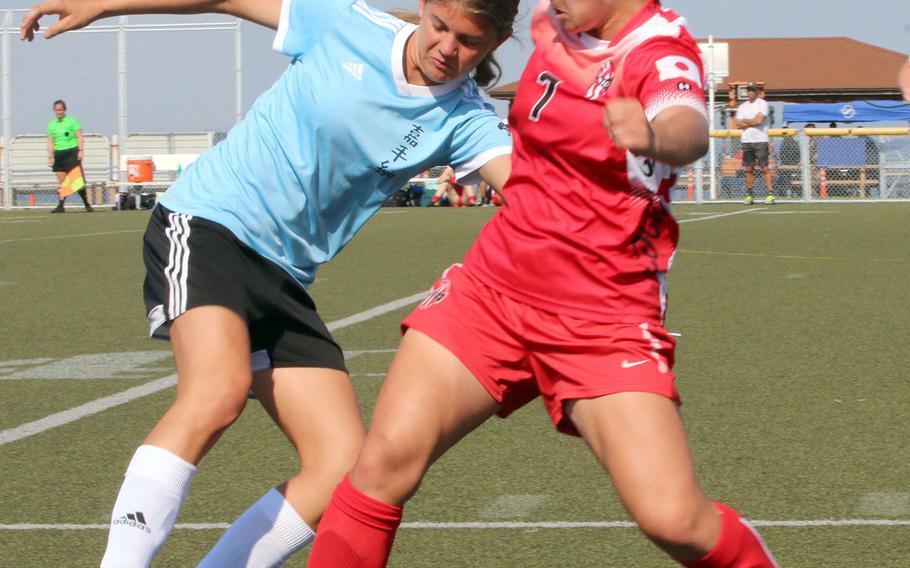 Kadena's Eliana Williams and Kinnick's Megan Thomas scuffle for the ball.