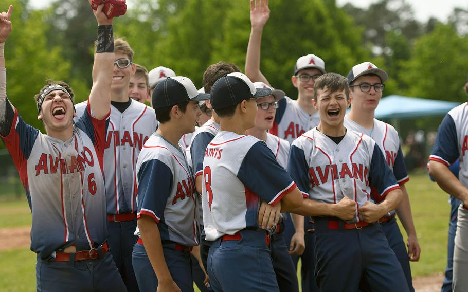 The Aviano Saints celebrate the school's first baseball champsionship after defeating the Spangdahlem Sentinels in the DODEA-Europe Division II championship game on Saturday, May 25, 2019.