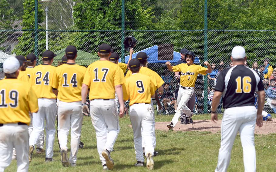 Stuttgart celebrates a home run by Tyler Savage in the championship game of the DODEA-Europe Division I baseball championships on Saturday, May 25, 2019. Ramstein won the game 5-4.