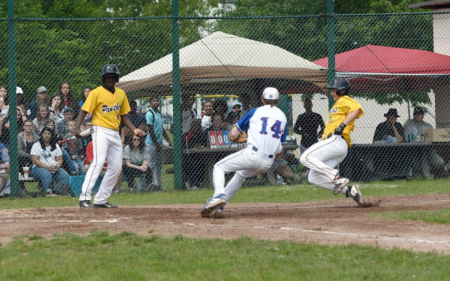 Stuttgart's Wesley Coglianese heads for home, while Ramstein's Tieran Shoffner blocks the way in the Royals' 5-4 victory in the championship game of the DODEA-Europe Divsion I championship on Saturday, May 25, 2019.
