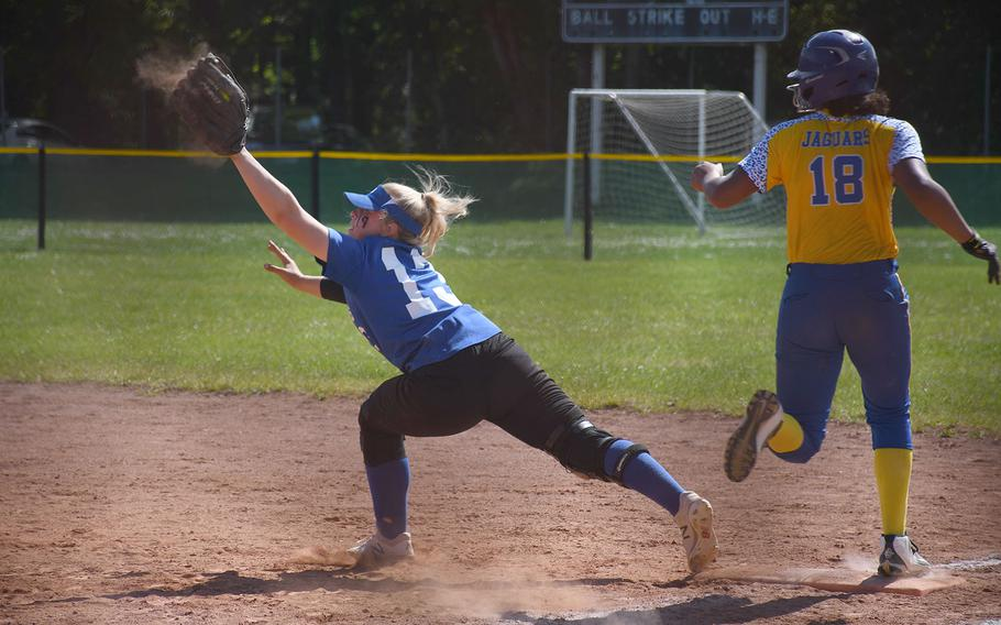 Rota's Emma Bond catches the ball as Sigonella's D'Anna Holland arrives at first in the Jaguars' 11-1 victory over the Admirals in the DODEA-Europe Division II/III title game on Saturday, May 25, 2019.