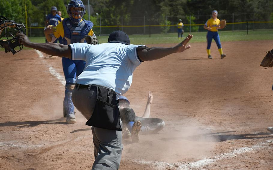 Safe! Rota scores a run in the DODEA-Europe Division II/III softball championships on Saturday, May 25, 2019. Sigonella, however, won the game - and the title - 11-1.