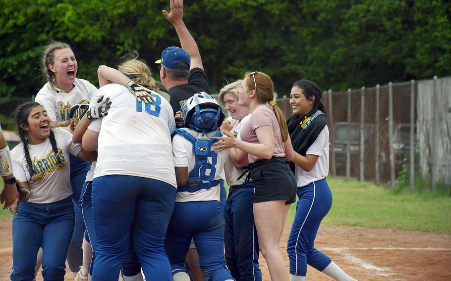 The Wiesbaden Warriors celebrate an unlikely DODEA-Europe Division I softball title on Saturday, May 25, 2019. The Warriors were 4-10 during the regular season before winning all but one of their games in the post-season tournament.