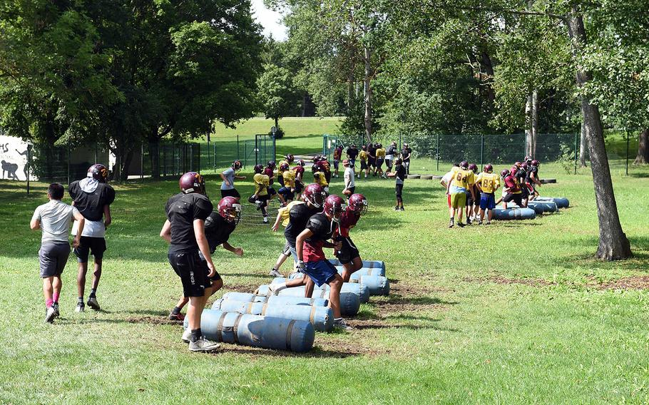 The Vilseck Falcons take on agility stations during practice at Vilseck, Germany, Wednesday, Aug. 21, 2019.