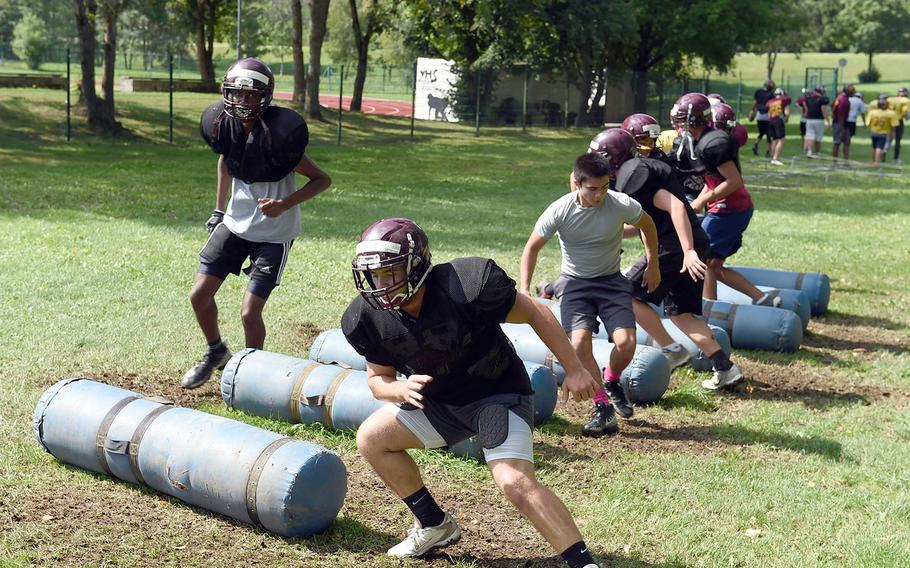 The Vilseck Falcons manuever through agility drills during practice at Vilseck, Germany, Wednesday, Aug. 21, 2019.