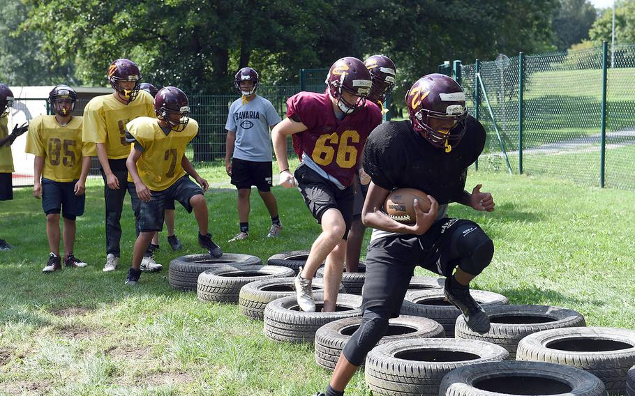 Vilseck Falcons manuever through agility drills during practice at Vilseck, Germany, Wednesday, Aug. 21, 2019.