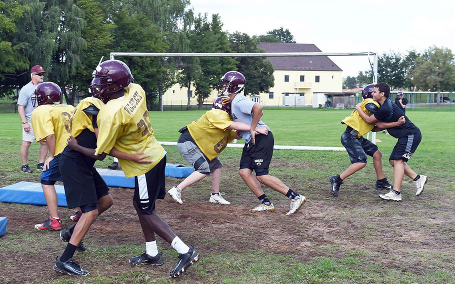 Vilseck Falcons work on tackling during practice at Vilseck, Germany, Wednesday, Aug. 21, 2019.
