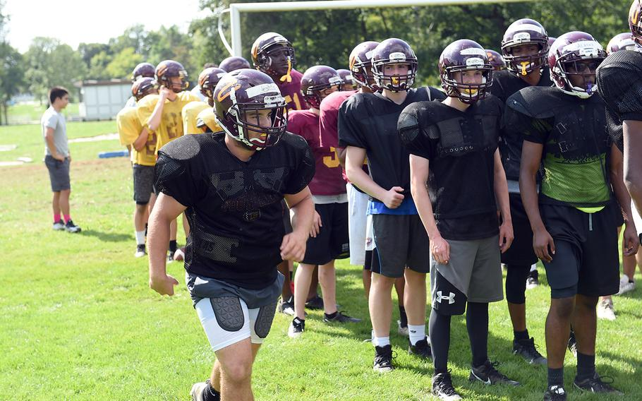 Vilseck's Jordan Leighty, a running back, jogs past his team during practice at Vilseck, Germany, Wednesday, Aug. 21, 2019.