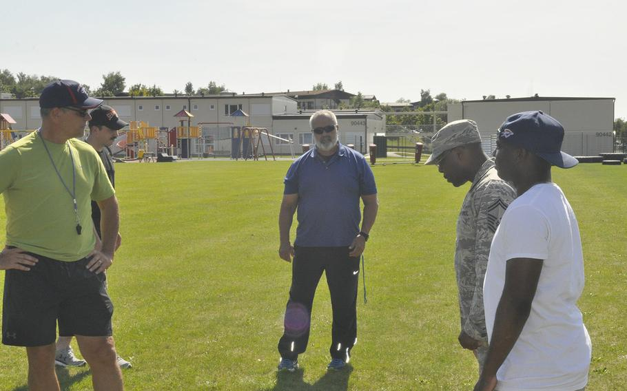 Head coach Mike Laue, center, talks with the Spangdahlem Sentinels football coaching staff Thursday, Aug. 22, 2019, at Spangdahlem Air Base. Laue, one of DODEA-Europe's most accomplished coaches, returns to the sideline this fall after a one year hiatus.