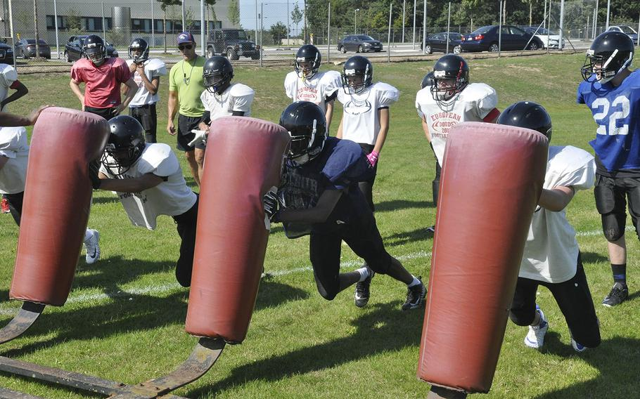 Spangdahlem Sentinels football players attack a tackling dummy in a preseason practice Thursday, Aug. 22, 2019 at Spangdahlem Air Base. The Sentinels are transitioning from 11-man to six-man football this fall, emphasizing the importance of open-field tackling.