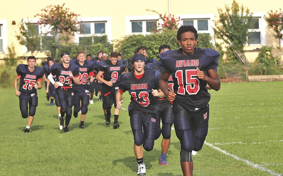 The Aviano Saints football team runs as part of a training session in preparation for their opening game of the 2019-20 school year. The Saints are the DODEA-Europe Division II defending champions.