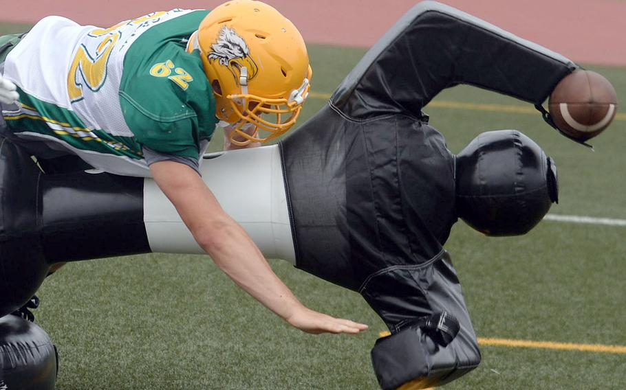 """Edgren senior Chase Quigley, whom coach Jeremy Sanders calls his """"elite dude,"""" hits the quarterback dummy during tackling drills."""