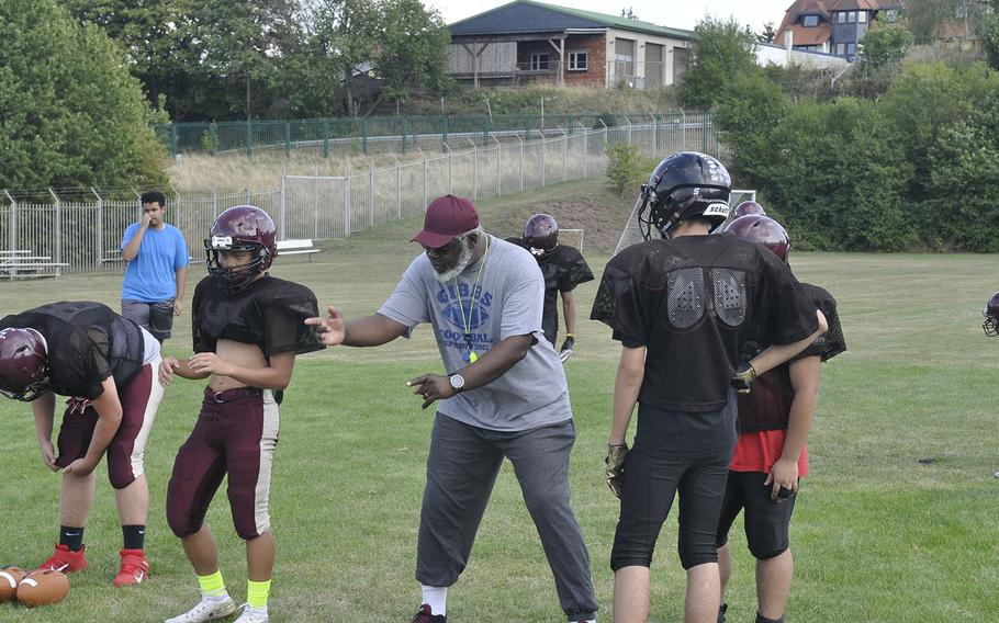 Head coach Phillip Loyd instructs Baumholder Bucs players during a preseason football practice Wednesday, Aug. 28, 2019, at Baumholder, Germany. The Bucs have a full preseason to prepare for their six-man league after a late arrival to the division last summer.
