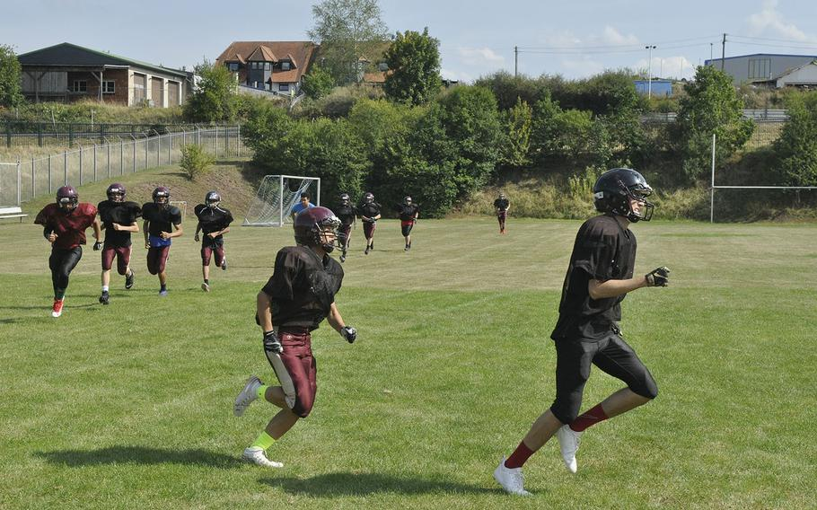 The Baumholder Bucs are emphasizing endurance, including these laps around their practice field Wednesday, Aug. 28, 2019, at Baumholder, Germany, to prepare for a six-man brand of football that requires regular long runs on offense and defense.