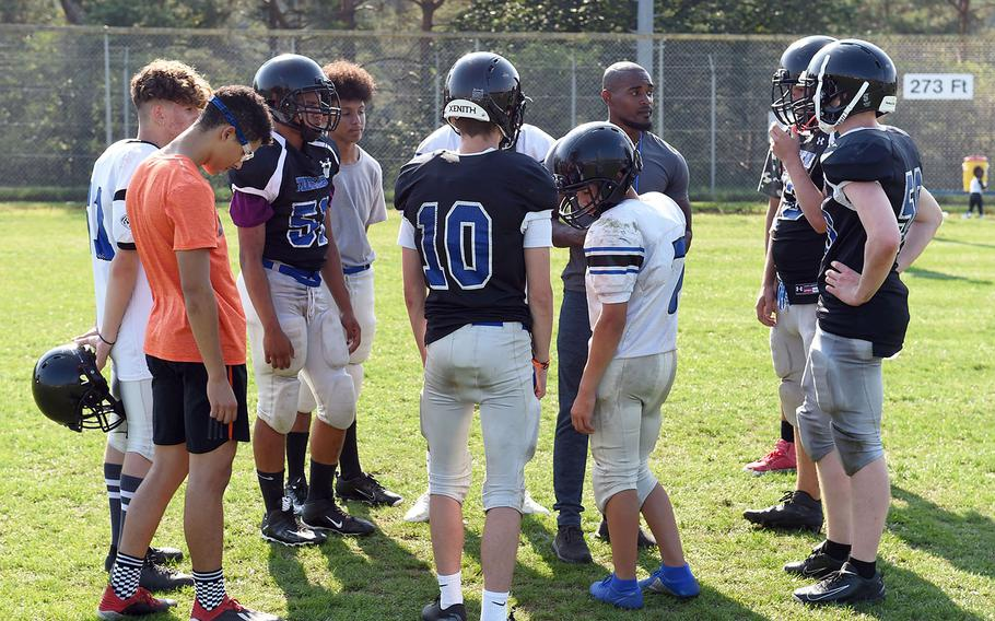 The Hohenfels Tigers go over plays during practice on Wednesday, Aug. 28, 2019.