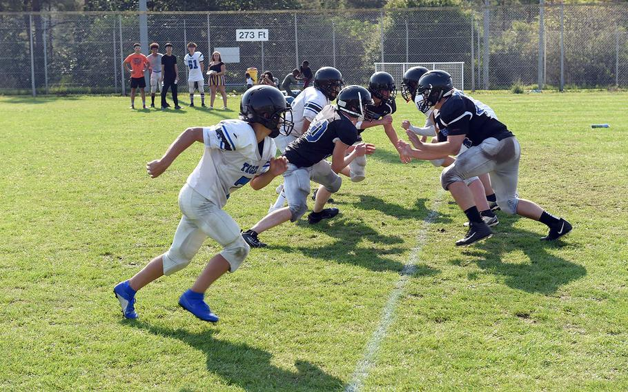 Hohenfels Tigers face each other during practice on Wednesday, Aug. 28, 2019.