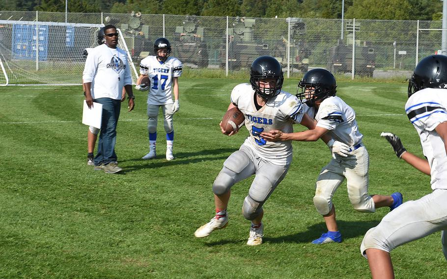 Hohenfels Tiger Brylon Young tackles quarterback Ryan Hale during practice on Wednesday, Aug. 28, 2019.