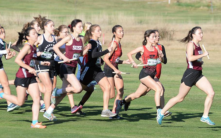Led by Nile C. Kinnick's Lilyana Clemons, the girls pack makes its way off the start line to open Tuesday's team relay.