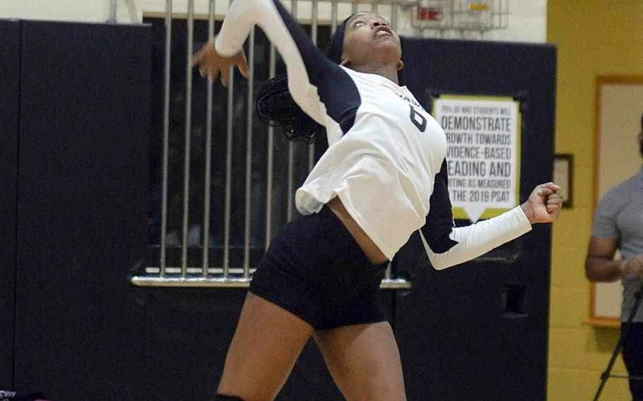 Jalynn Knight brings a jump serve to the court for host Humphreys in the Division I tournament.