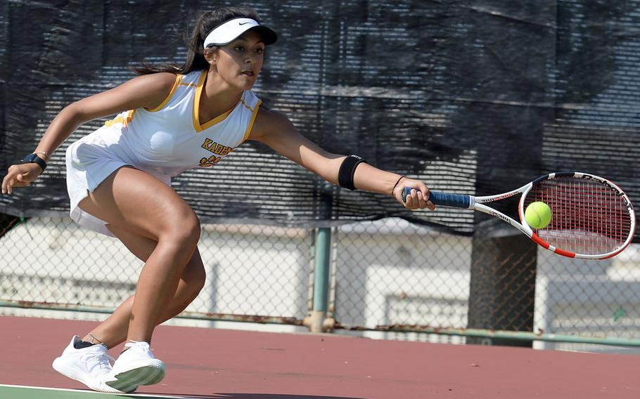 Kadena sophomore Ally Johnson lunges for a forehand return during her Far East tennis singles quarterfinal victory.