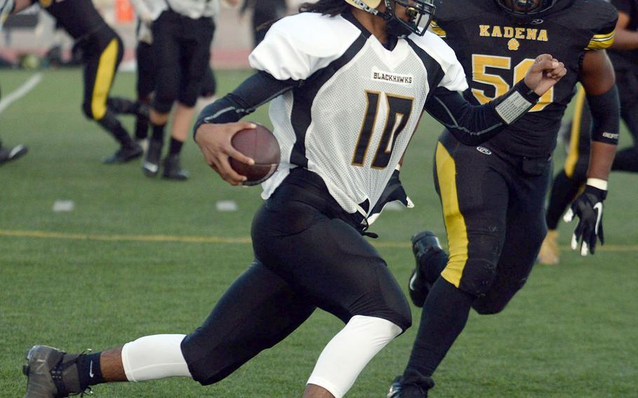 Humphreys' quarterback Deontaye Gregory skirts right end past Kadena's Caleb Wise.