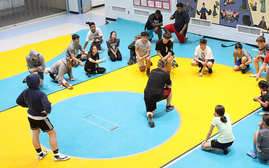 From two wrestlers two years ago and six last year, Osan's wrestling team now has as many as 26, four of them girls, pradticing in the school cafeteria daily.